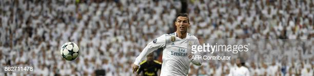 TOPSHOT Real Madrid's Portuguese forward Cristiano Ronaldo runs with the ball during the UEFA Champions League group H football match Real Madrid CF...