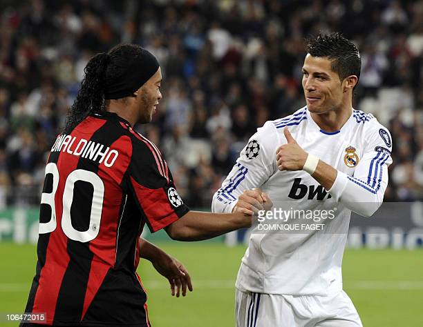 Real Madrid's Portuguese forward Cristiano Ronaldo salutes AC Milan's Brazilian forward Ronaldinho before the UEFA Champions League Group G football...