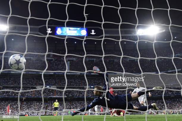 TOPSHOT Real Madrid's Portuguese forward Cristiano Ronaldo scores a goal a goal during the UEFA Champions League quarterfinal second leg football...
