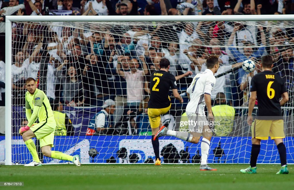 Real Madrid's Portuguese forward Cristiano Ronaldo (2R) scores a goal during the UEFA Champions League semifinal first leg football match Real Madrid CF vs Club Atletico de Madrid at the Santiago Bernabeu stadium in Madrid, on May 2, 2017. /