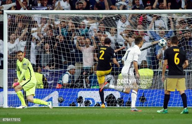 Real Madrid's Portuguese forward Cristiano Ronaldo scores a goal during the UEFA Champions League semifinal first leg football match Real Madrid CF...