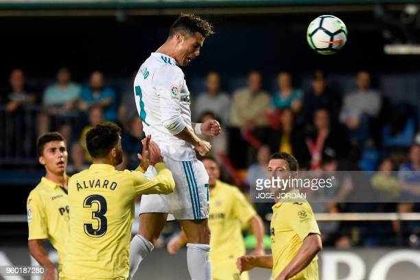 TOPSHOT Real Madrid's Portuguese forward Cristiano Ronaldo scores a header during the Spanish league football match between Villarreal CF and Real...