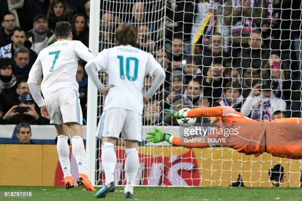 Real Madrid's Portuguese forward Cristiano Ronaldo scores a penalty againt Paris SaintGermain's French goalkeeper Alphonse Areola during the UEFA...