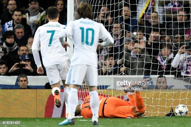 Real Madrid's Portuguese forward Cristiano Ronaldo scores a penalty against Paris SaintGermain's French goalkeeper Alphonse Areola during the UEFA...