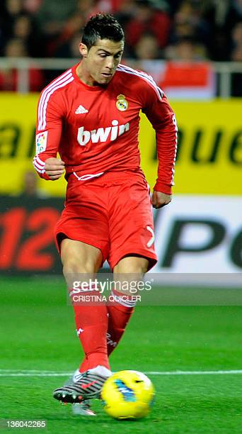 Real Madrid's Portuguese forward Cristiano Ronaldo scores against Sevilla during their Spanish League football match on December 17 2011 at Ramon...