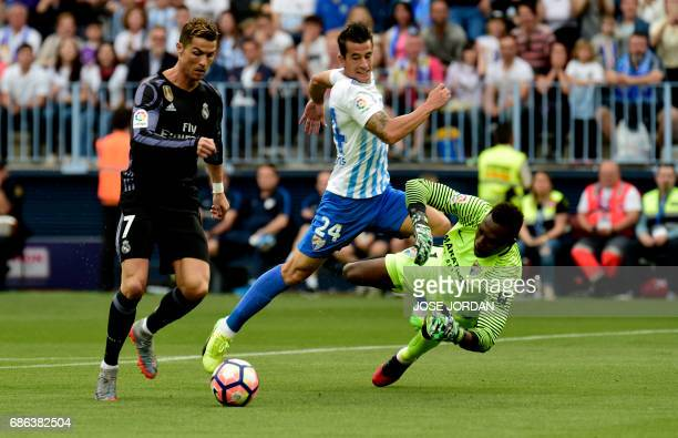 Real Madrid's Portuguese forward Cristiano Ronaldo scores during the Spanish league football match Malaga CF vs Real Madrid CF at La Rosaleda stadium...