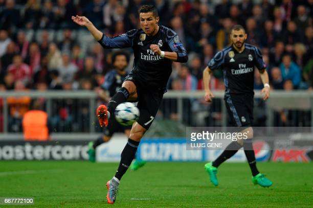 Real Madrid's Portuguese forward Cristiano Ronaldo scores the 11 during the UEFA Champions League 1st leg quarterfinal football match FC Bayern...