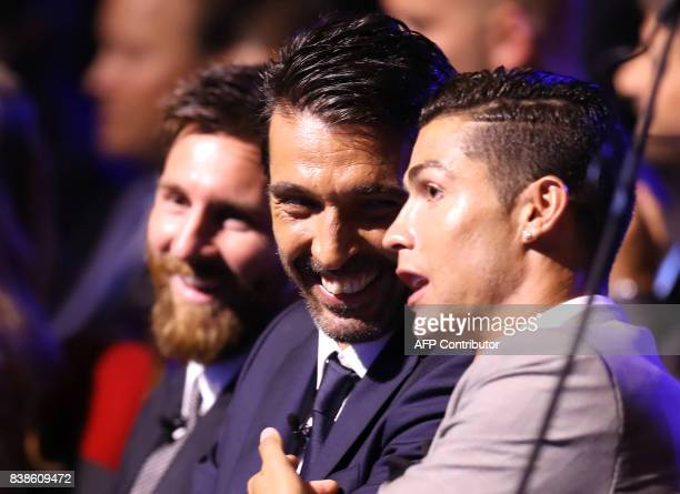 Real Madrid's Portuguese forward Cristiano Ronaldo shares a light moment with Juventus's Italian goalkeeper Gianluigi Buffon and Barcelona's...