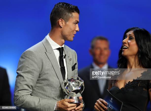 Real Madrid's Portuguese forward Cristiano Ronaldo shares a light moment with English sports journalist Reshmin Chowdhury after he was awarded the...