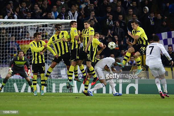 Real Madrid's Portuguese forward Cristiano Ronaldo shoots a free kick during the UEFA Champions League football match Real Madrid FC vs Borussia...