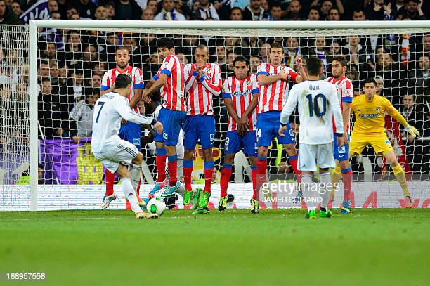 Real Madrid's Portuguese forward Cristiano Ronaldo shoots a free kick during the Spanish King's Cup final football match Real Madrid vs Atletico de...