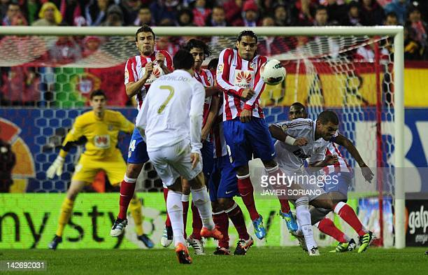 Real Madrid's Portuguese forward Cristiano Ronaldo shoots a kick and scores during the Spanish league football match Atletico Madrid against Real...