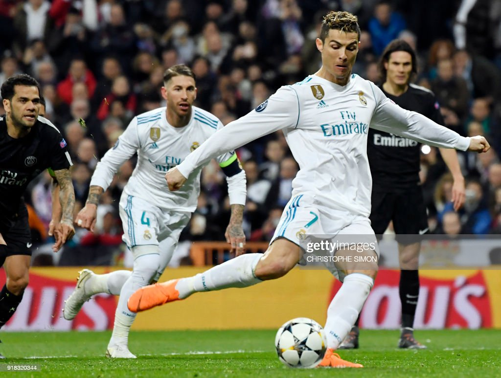 TOPSHOT - Real Madrid's Portuguese forward Cristiano Ronaldo shoots a penalty kick to score a goal during the UEFA Champions League round of sixteen first leg football match Real Madrid CF against Paris Saint-Germain (PSG) at the Santiago Bernabeu stadium in Madrid on February 14, 2018. /
