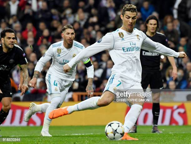 TOPSHOT Real Madrid's Portuguese forward Cristiano Ronaldo shoots a penalty kick to score a goal during the UEFA Champions League round of sixteen...
