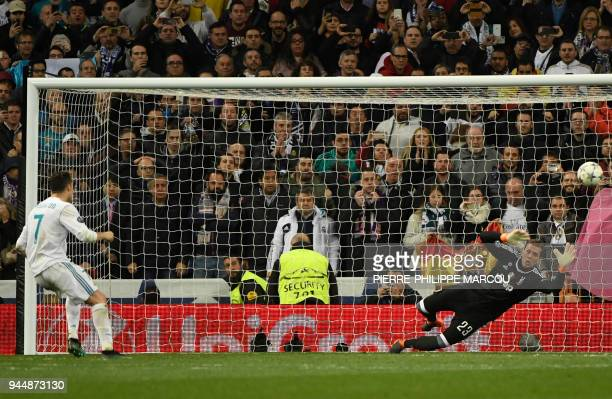 Real Madrid's Portuguese forward Cristiano Ronaldo shoots a penalty kick to score a goal during the UEFA Champions League quarterfinal second leg...