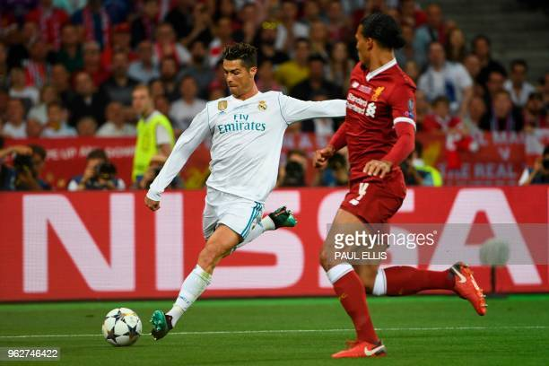 Real Madrid's Portuguese forward Cristiano Ronaldo shoots past Liverpool's Dutch defender Virgil Van Dijk but over the bar during the UEFA Champions...
