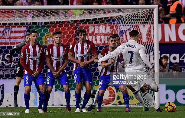 Real Madrid's Portuguese forward Cristiano Ronaldo shoots to score a goal during the Spanish league football match between Club Atletico de Madrid...