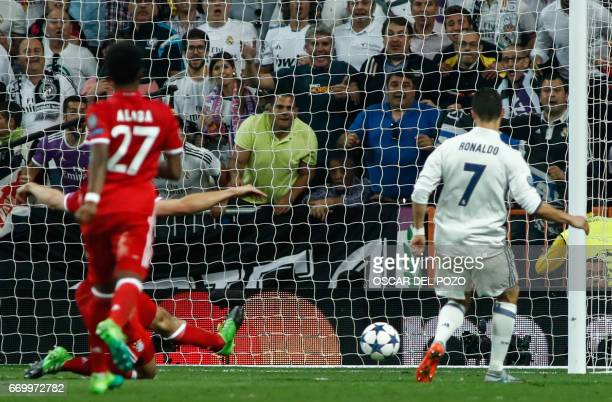 Real Madrid's Portuguese forward Cristiano Ronaldo shoots to score a goal during the UEFA Champions League quarterfinal second leg football match...