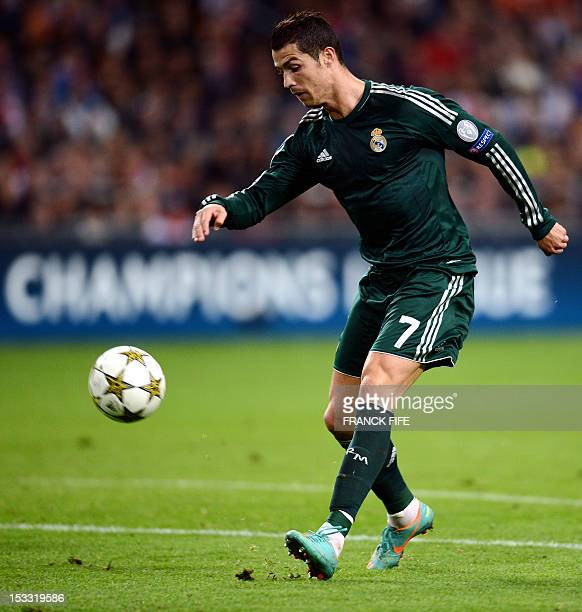 Real Madrid's Portuguese forward Cristiano Ronaldo shoots to score during the UEFA Champions League Group D football match Ajax Amsterdam vs Real...
