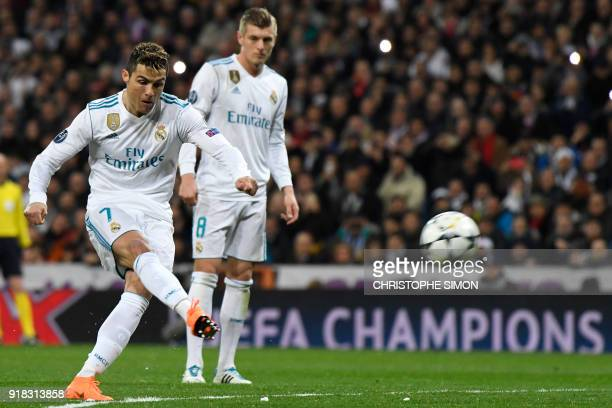 Real Madrid's Portuguese forward Cristiano Ronaldo shots a penalty kick during the UEFA Champions League round of sixteen first leg football match...