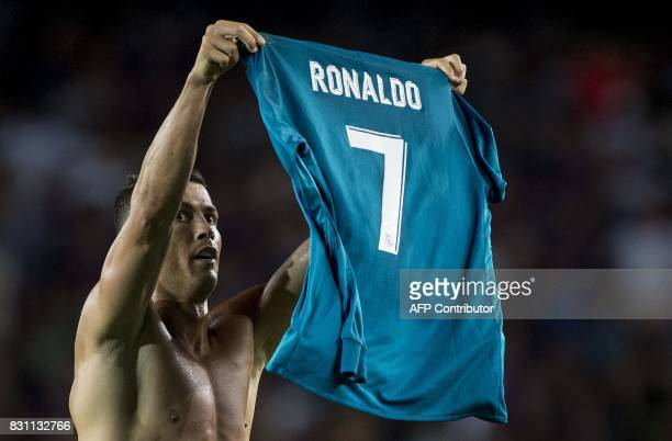Real Madrid's Portuguese forward Cristiano Ronaldo shows his jersey to celebrate his goal during the first leg of the Spanish Supercup football match...