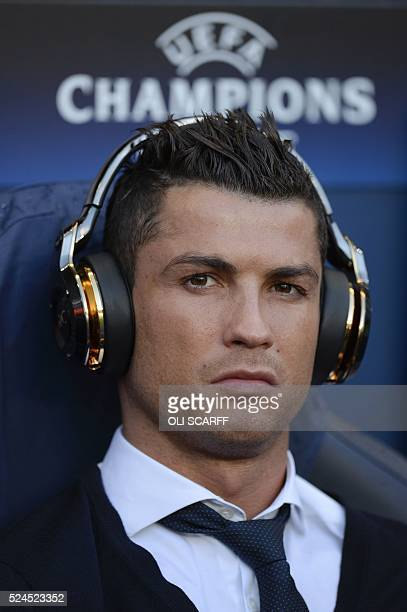 Real Madrid's Portuguese forward Cristiano Ronaldo sits in the dug-out ahead of kick off of the UEFA Champions League semi-final first leg football...