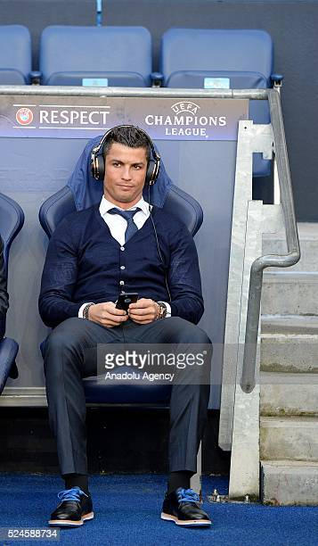 Real Madrid's Portuguese forward Cristiano Ronaldo sits in the dugout ahead of kick off of the UEFA Champions League semifinal first leg football...