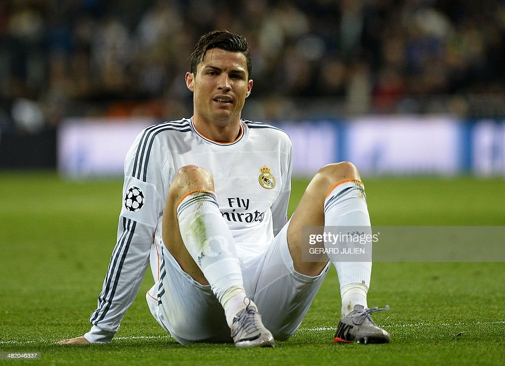 Real Madrid's Portuguese forward Cristiano Ronaldo sits on the ground during the UEFA Champions League quarterfinal first leg football match Real Madrid FC vs Borussia Dortmund at the Santiago Bernabeu stadium in Madrid on April 2, 2014.