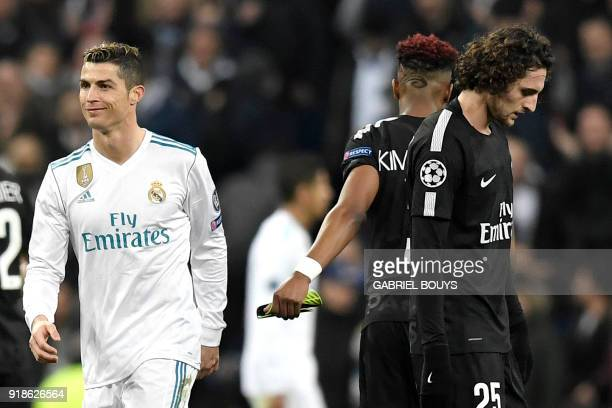 Real Madrid's Portuguese forward Cristiano Ronaldo smiles beside Paris SaintGermain's French midfielder Adrien Rabiot during the UEFA Champions...
