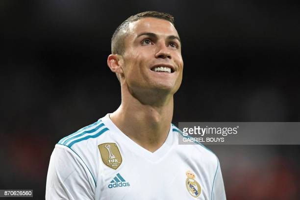 Real Madrid's Portuguese forward Cristiano Ronaldo smiles during the Spanish league football match Real Madrid CF vs UD Las Palmas at the Santiago...
