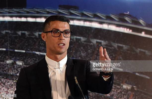 Real Madrid's Portuguese forward Cristiano Ronaldo speaks during the official presentation of his contract renewal in the presidential box at the...