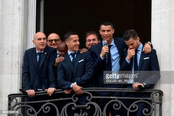Real Madrid's Portuguese forward Cristiano Ronaldo speaks next to Real Madrid's Spanish midfielder Lucas Vazquez and Real Madrid's Spanish defender...