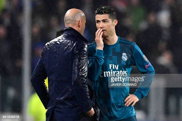 Real Madrid's Portuguese forward Cristiano Ronaldo speaks with Real Madrid's French coach Zinedine Zidane during the UEFA Champions League...