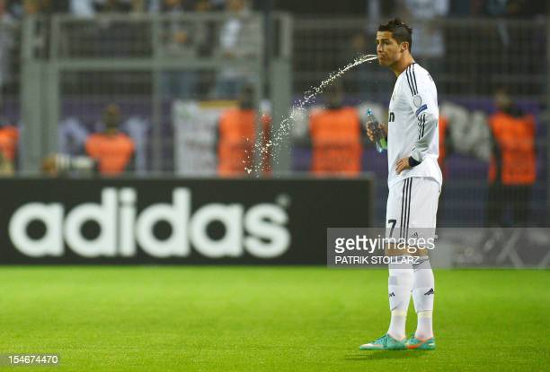 Real Madrid's Portuguese forward Cristiano Ronaldo spits water prior to the UEFA Champions League Group D football match BVB Borussia Dortmund vs...