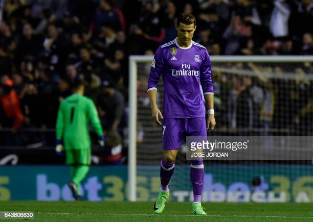 TOPSHOT Real Madrid's Portuguese forward Cristiano Ronaldo stands after a goal by Valencia during the Spanish league football match Valencia CF vs...