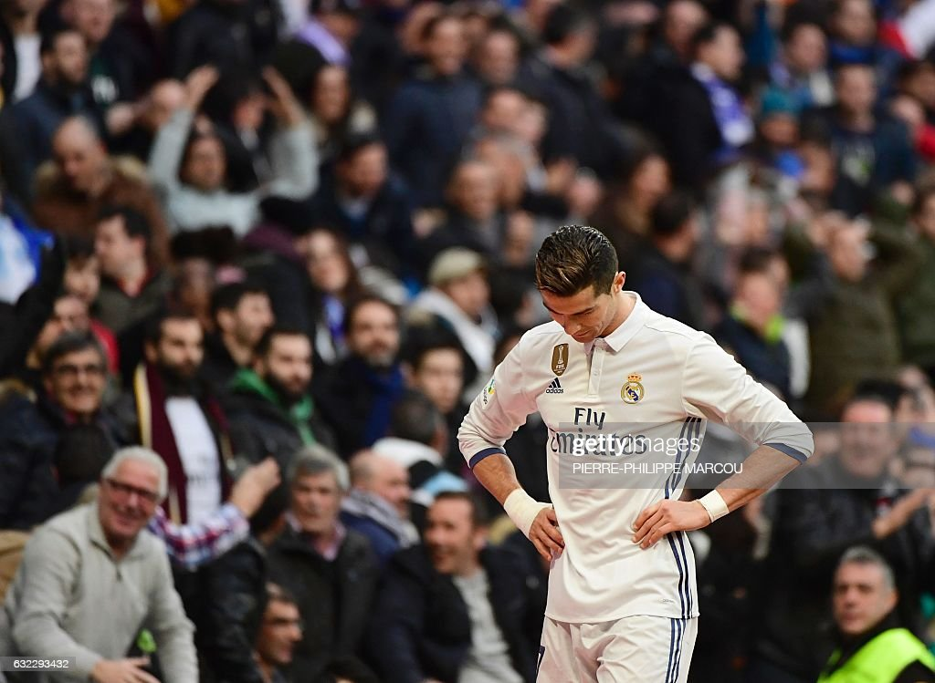 Real Madrid's Portuguese forward Cristiano Ronaldo stands during the Spanish league football match Real Madrid CF vs Malaga CF at the Santiago Bernabeu stadium in Madrid on January 21, 2017. / AFP / PIERRE