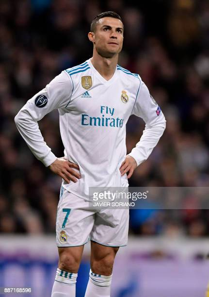 Real Madrid's Portuguese forward Cristiano Ronaldo stands on the field during the UEFA Champions League group H football match Real Madrid CF vs...
