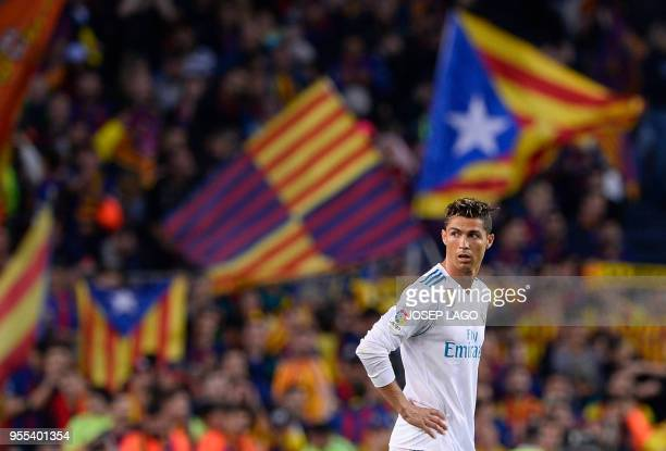 Real Madrid's Portuguese forward Cristiano Ronaldo stands on the field after Barcelona's goal during the Spanish league football match between FC...