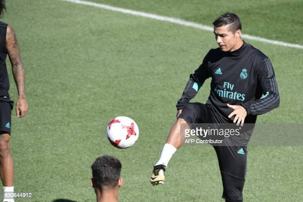 Real Madrid's Portuguese forward Cristiano Ronaldo takes part in a training session at Real Madrid sport city in Madrid on August 12 on the eve of...