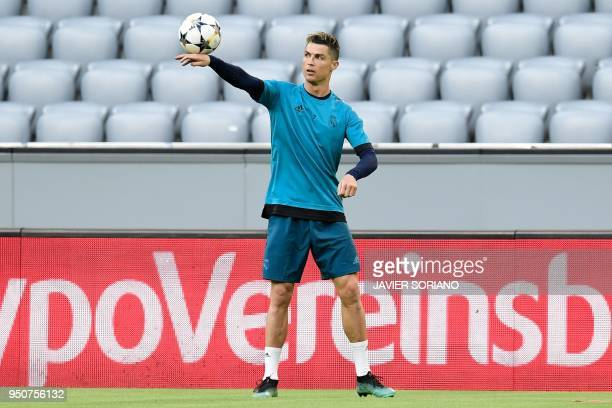 Real Madrid's Portuguese forward Cristiano Ronaldo takes part in a training session on the eve of the UEFA Champions League semifinal firstleg...