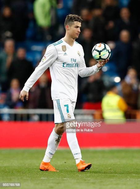 Real Madrid's Portuguese forward Cristiano Ronaldo takes the ball at the end of the Spanish League football match between Real Madrid CF and Girona...