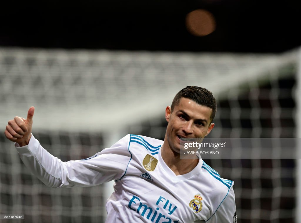 TOPSHOT - Real Madrid's Portuguese forward Cristiano Ronaldo thumbs up during the UEFA Champions League group H football match Real Madrid CF vs Borussia Dortmund at the Santiago Bernabeu stadium in Madrid on December 6, 2017. /