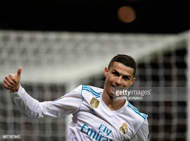 TOPSHOT Real Madrid's Portuguese forward Cristiano Ronaldo thumbs up during the UEFA Champions League group H football match Real Madrid CF vs...
