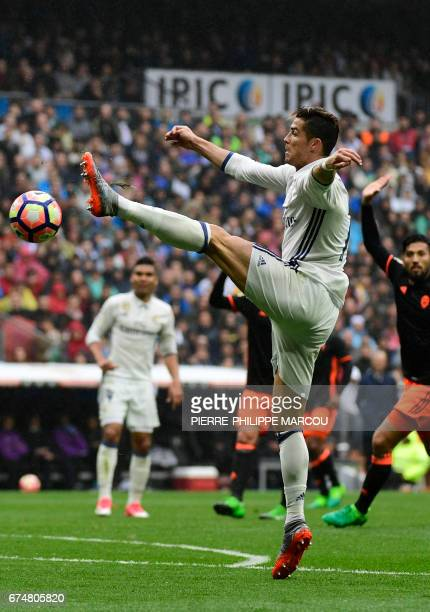 Real Madrid's Portuguese forward Cristiano Ronaldo tries to control the ball during the Spanish league football match Real Madrid CF vs Valencia CF...
