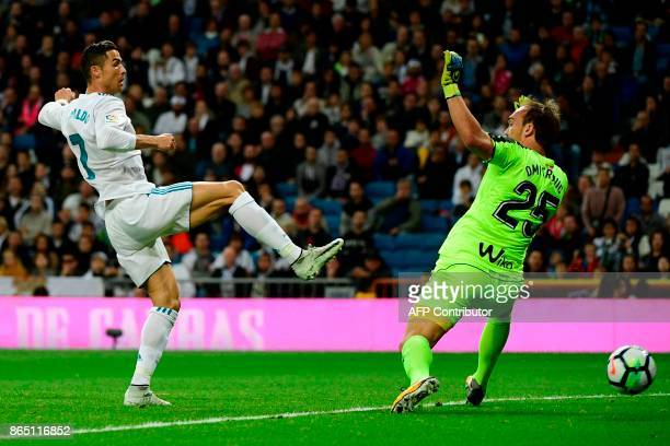 Real Madrid's Portuguese forward Cristiano Ronaldo tries to score past Eibar's Serbian goalkeeper Marko Dmitrovic during the Spanish league football...