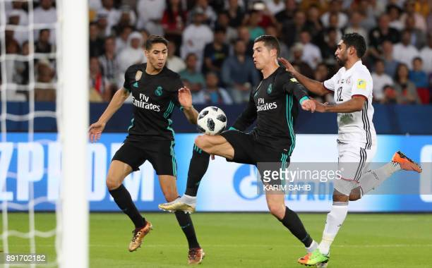Real Madrid's Portuguese forward Cristiano Ronaldo vies for the ball with alJazira's Emirati defender Salem Rashid during the FIFA Club World Cup...