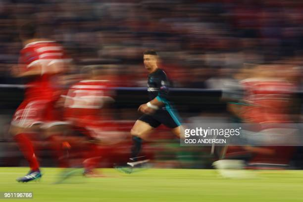 TOPSHOT Real Madrid's Portuguese forward Cristiano Ronaldo vies for the ball during the UEFA Champions League semifinal firstleg football match FC...