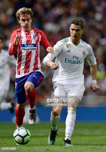 Real Madrid's Portuguese forward Cristiano Ronaldo vies with Atletico Madrid's French forward Antoine Griezmann during the Spanish league football...