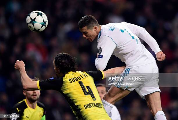 Real Madrid's Portuguese forward Cristiano Ronaldo vies with Dortmund's Serbian defender Neven Subotic during the UEFA Champions League group H...