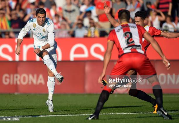 TOPSHOT Real Madrid's Portuguese forward Cristiano Ronaldo vies with Girona's Spanish defender Juan Pedro Ramirez during the Spanish league football...